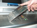 b2. Card skimming: The genuine keypad is covered with a fake, to dupe the customer