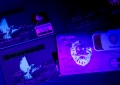 b5. Payment cards under UV light. The UV print lion's head is a genuine debit card while the others are counterfeit credit cards